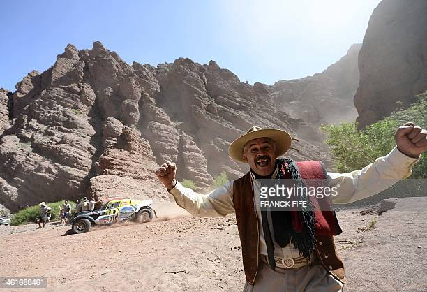 A person reacts during the Stage 6 of the Dakar 2014 between Tucuman and Salta Argentina on January 9 2014 AFP PHOTO / FRANCK FIFE
