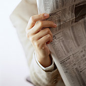 Person Reading the Financial Page