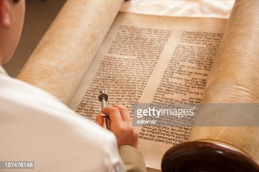 Person reading the historic words of the Torah