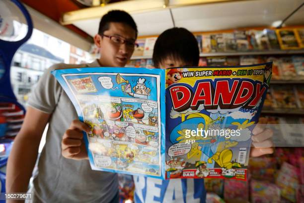 A person reads a copy of the children's comic The Dandy at a news agent in central London on August 14 2012 Publishers DC Thompson based in Dundee...