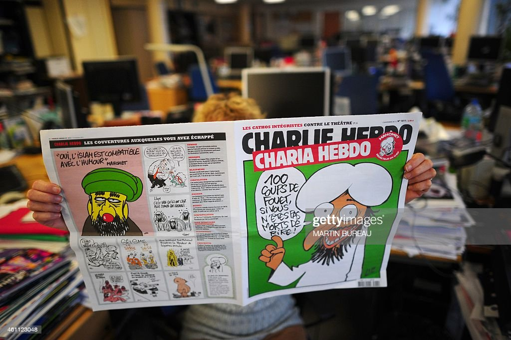 A person reads on November 1 2011 in Paris an issue of Satirical French magazine Charlie Hebdo to be published on November 2 whose cover features...
