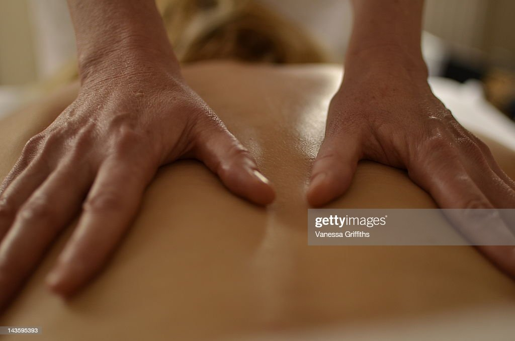 Person receiving back massage : Stock Photo