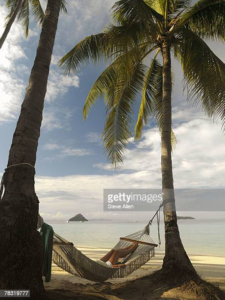 Person relaxing on a hammock, Phuket, Thailand