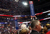 A person removes the sign for the Michigan delegation after Republican presidential candidate former Massachusetts Gov Mitt Romney accepted the...