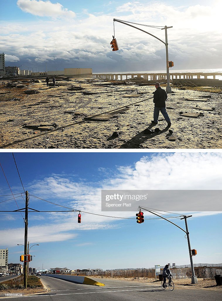 A man walks by the remains of part of the historic boardwalk after large parts of it were washed away during Hurricane Sandy on October 31 2012 in...