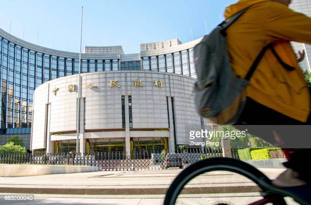 A person rides a bike past the PBoC To offer a longtime and sustainable financial support for the 'One belt One road' initiative China's central bank...