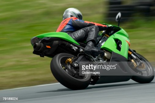Person riding a motorcycle on a motor racing track : Stock Photo