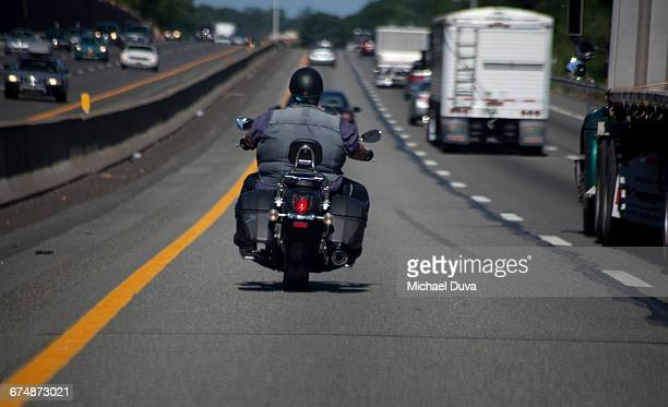 person riding motorcycle on highway