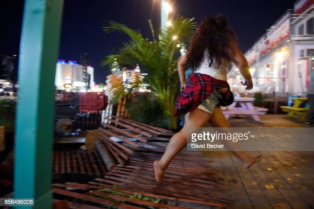 A person runs from the Route 91 Harvest country music festival after apparent gun fire was heard on October 1 2017 in Las Vegas Nevada There are...