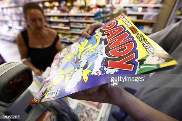 A person scans the barcode of the children's comic The Dandy at a news agent in central London on August 14 2012 Publishers DC Thompson based in...