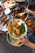 Person serving prepared street food