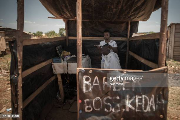 A person shaves a hair salon in Mashunaland Harare Zimbabwe on 8 November 2017 This village did not exist five years ago because there is no water in...