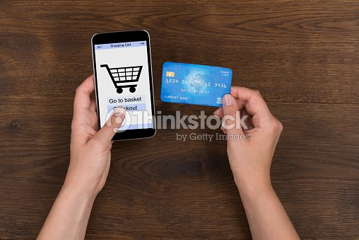 27a4f80a174 Person Shopping Online With Credit Card On Mobile Phone Stock Photo ...