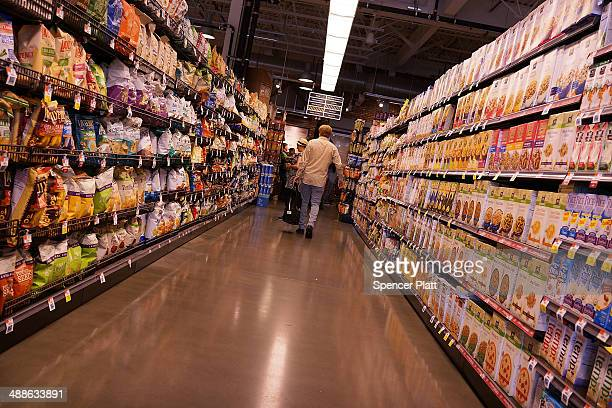 A person shops in Whole Foods Market in the Brooklyn borough on May 7 2014 in New York City Whole Foods Market an upscale grocery store that sells...
