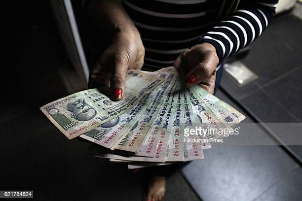 A person showing hundred rupee notes taken out of ATMs on November 8 2016 in New Delhi India Prime Minister Narendra Modi in his 40minute speech...