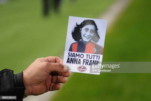 A person shows an image of holocaust victim Anne Frank with reading 'We are all Anne Frank' prior the Italian Serie A football match Bologna vs Lazio...