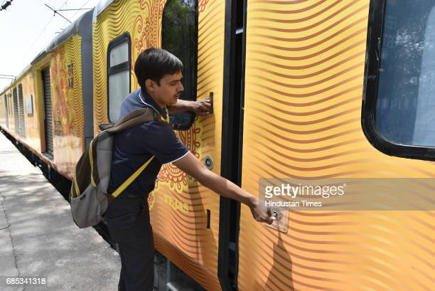 A person shows automatic entrance plug door in Tejas Express train standing at Delhi's Safdarjung station on May 19 2017 in New Delhi India The...