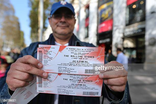 A person shows on October 25 2012 in Paris tickets for a concert held the same day in the French capital by British rock legends The Rolling Stones...