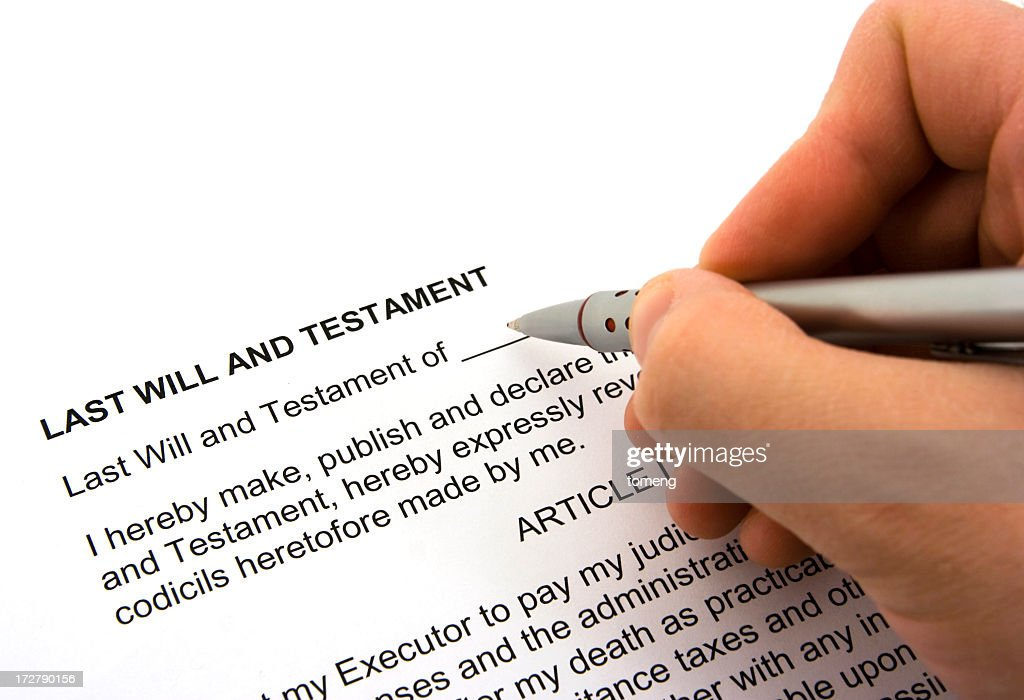 Person Signing A Will And Testament Form Stock Photo | Getty Images