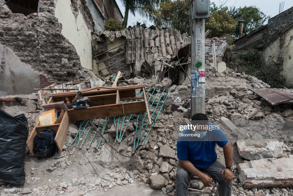 A person sits in front of a collapsed building in the town of Jojutla de Juarez, Morelos State, Mexico, on Wednesday, Sept. 20, 2017. At least 225 have been killed following a 7.1 magnitude earthquake that struck near Mexico City Tuesday. It came just hours after annual safety drills were held on the anniversary of a 1985 earthquake that killed 5,000. Photographer: Cesar Rodriguez/Bloomberg via Getty Images