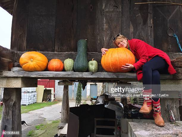 Person Sitting With Vegetables