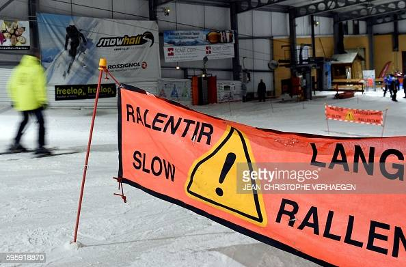 A person skies at the Snowhall the only indoor ski run in France in Amneville eastern France on August 26 2016 as a heatwave strikes all France In...
