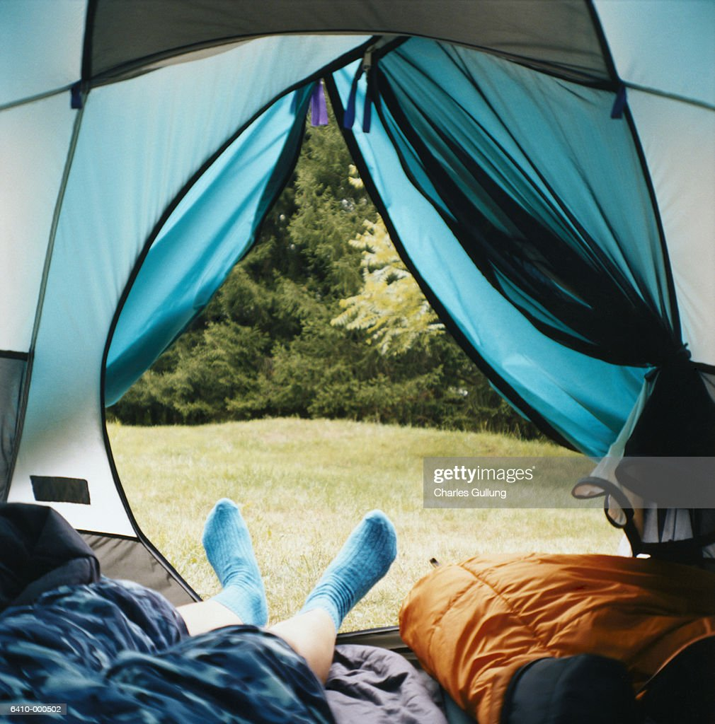 Person Sleeping in Tent : Stock Photo