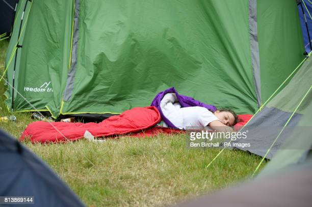 A person sleeps amongst tents at Glastonbury Festival Worthy Farm Somerset PRESS ASSOCIATION Photo Picture date Sunday June 2017 Photo credit should...