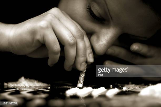 Person snorting cocaine due to addiction