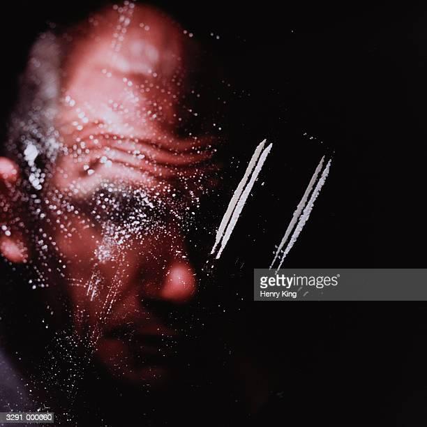Person Snorting Cocaine
