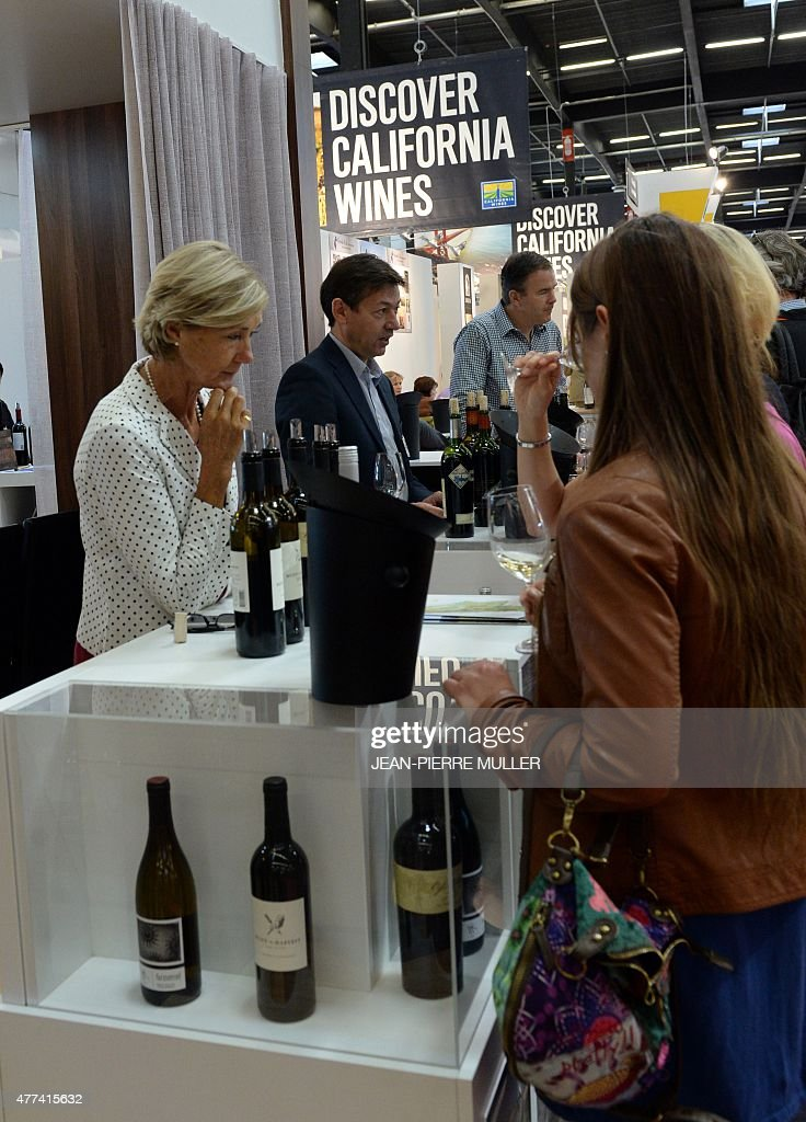 A person speaks about California's wines on a stand of the ...