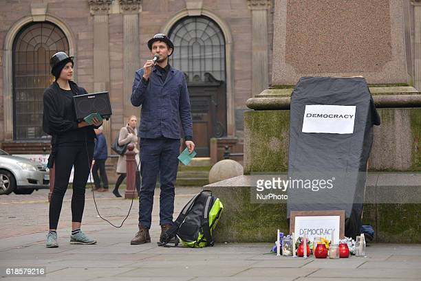 A person speaks about CETA at a mock burial site during a demonstration in solidarity with the people of Wallonia against 'CETA' on October 27 2016...