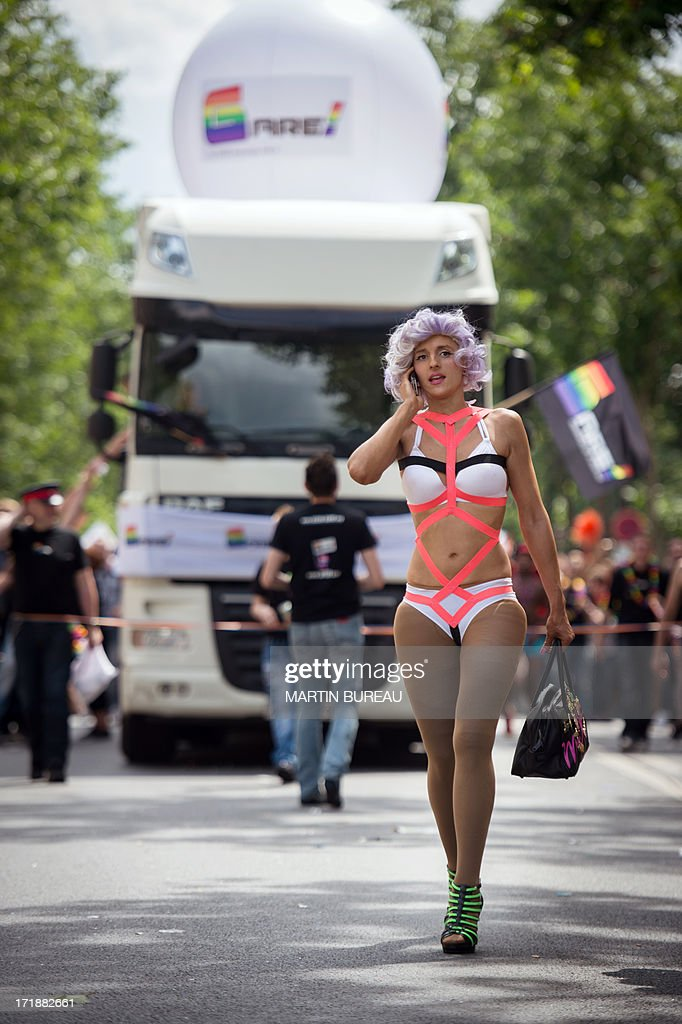 A person speaks on her mobile as she attends the homosexual, lesbian, bisexual and transgender (HLBT) visibility march, the Gay Pride, on June 29, 2013 in Paris, exactly one month to the day since France celebrated its first gay marriage.
