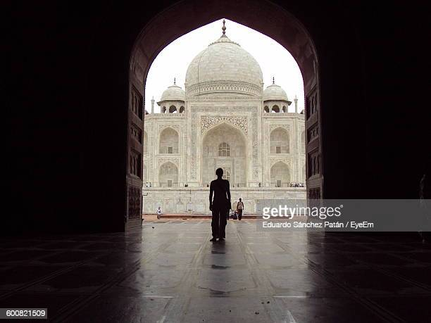 Person Standing At Archway In Front Of Taj Mahal