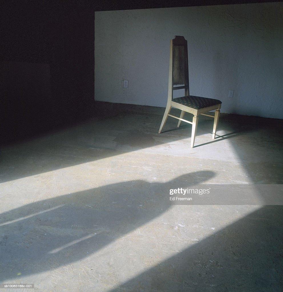 Person standing in doorway shadow on floor : Stock Photo