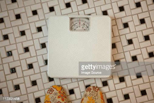 Person Standing In Front Of Bathroom Scales Stock Photo ...