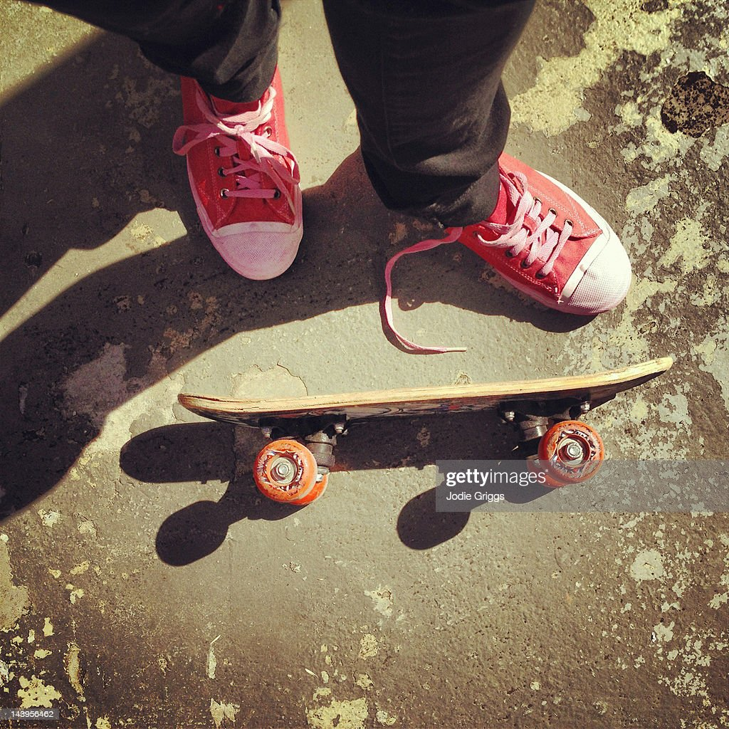 Person standing next to skateboard