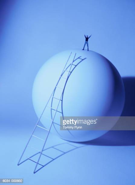 Person Standing on Sphere