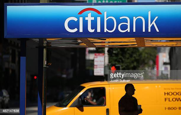 A person stands near a Citibank branch office on July 14 2014 in San Francisco California After several months of negotiations with the US Department...