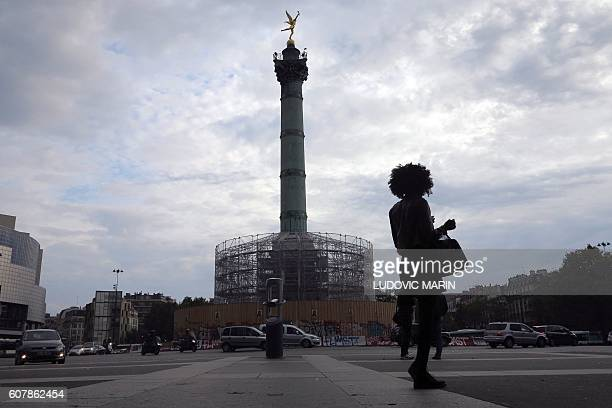 A person stands near the Bastille column under renovation on September 19 2016 Renovation will last until 2018 and will allow visitor to visit the...