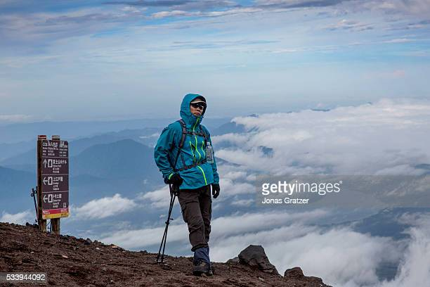 A person stands on Mount Fuji