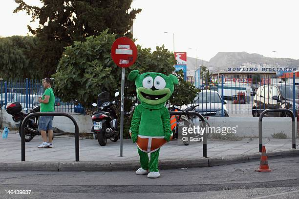 A person stands outside a fun fair wearing a cartoon monster costume on June 16 2012 in Athens Greece The Greek electorate are due to go to the polls...
