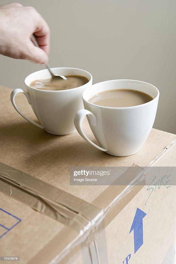 Person stirring tea
