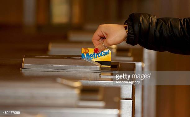 A person swipes a metrocard in New York subway station on January 13 2014 in New York United States The Metropolitan Transportation Authority...