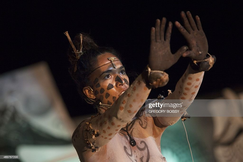 A person takes part in an oratorical art to tell legends using corporal paintings words and body language in Hanga Roa on Chile's Easter Island in...