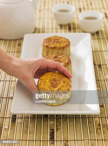 Person taking Chinese moon cake : Stock Photo
