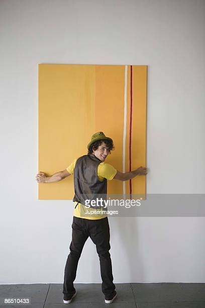 Person taking down painting