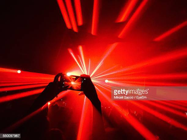 Person Taking Picture At Night Club Party