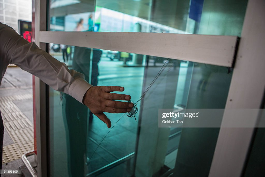 A person touches the bullet hole left on the window at the country's largest airport, Istanbul Ataturk, following yesterday's blast on June 29, 2016 in Istanbul, Turkey. Three suicide bombers opened fire before blowing themselves up at the entrance to the main international airport in Istanbul yesterday. The Istanbul Governor's Office says 41 people have been killed, 37 of the victims have been identified, including 10 foreign nationals and three people with dual citizenship. More than 230 people were wounded but 109 have been discharged from hospitals in the deadly suicide bombing attack in Istanbul's Ataturk airport blamed on the Islamic State group.