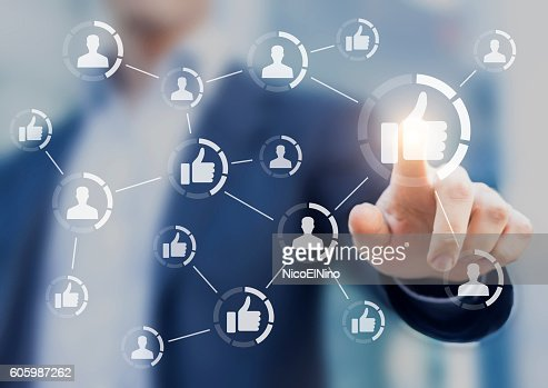 Person touching like buttons. Concept about social media network : Stock Photo